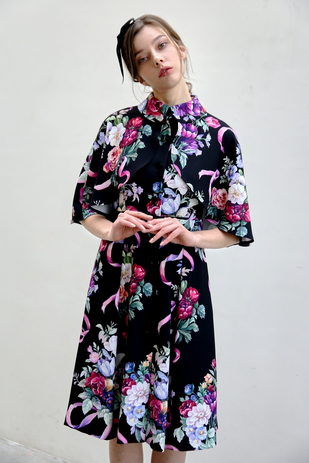 Define cape dress (Flower bouquet)